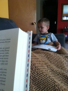 "My favorite reading buddy. I'm reading ""To the Letter,"" Theo is reading ""Animal Encyclopedia"""