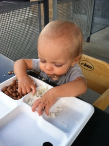 Yup. That's my boy, feeding himself pinto beans and rice. Eating out has never been easier.