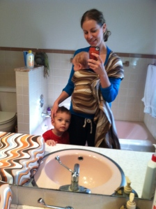 Mommy wearing Oliver in her ring sling.