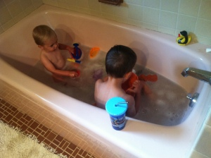 "boys in the tub, Theo armed with the ""barf bucket"""