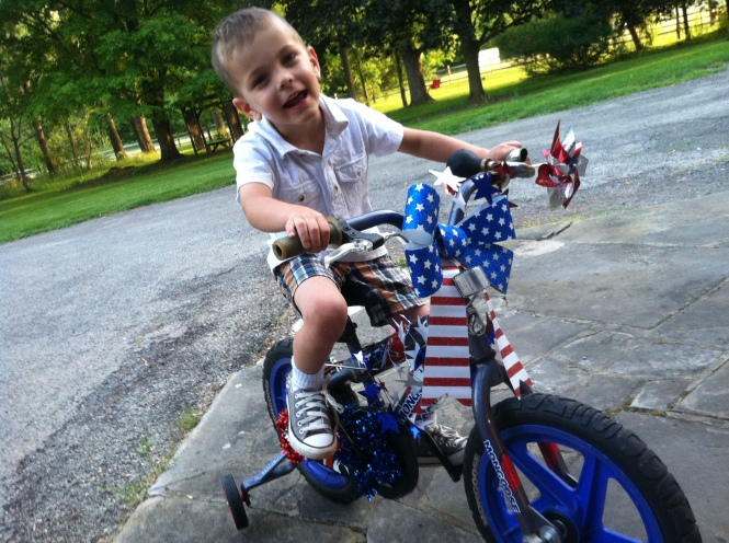 Theo on bike for parade. Memorial Day, Hot Air Balloons and Other Things I Never Cared About Before Kids