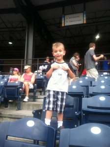 theo at his first ball game. take me out to the ball game