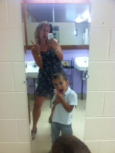 Teaching Theo the ancient art of how to keep it classy at a wedding. #bathroomselfie