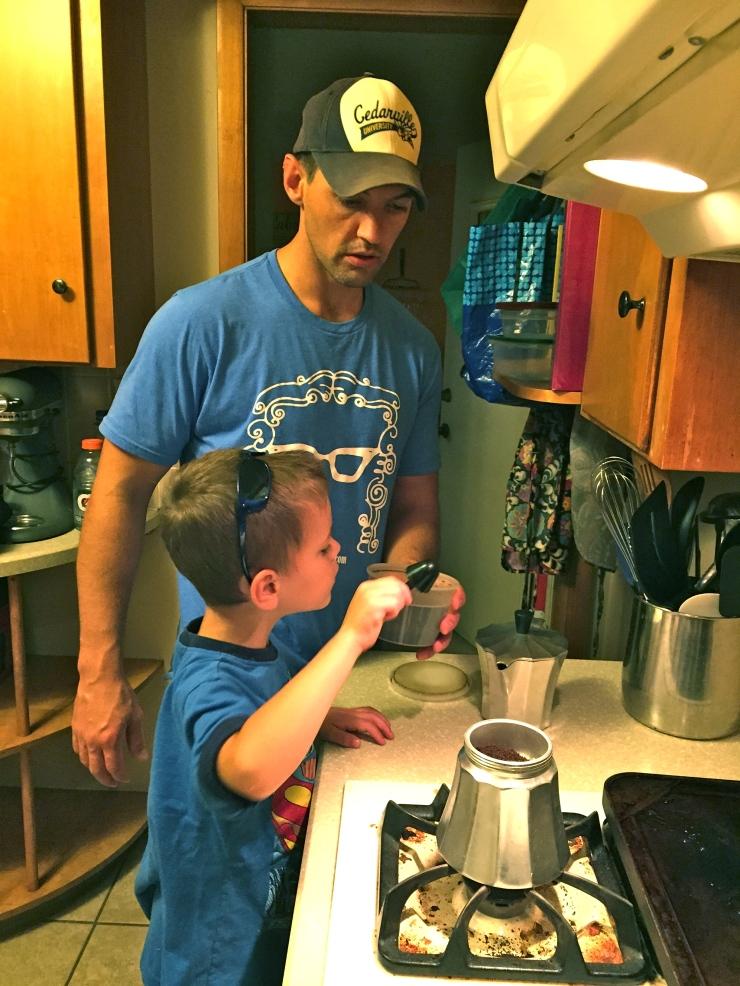 Adding coffee to the espresso maker.