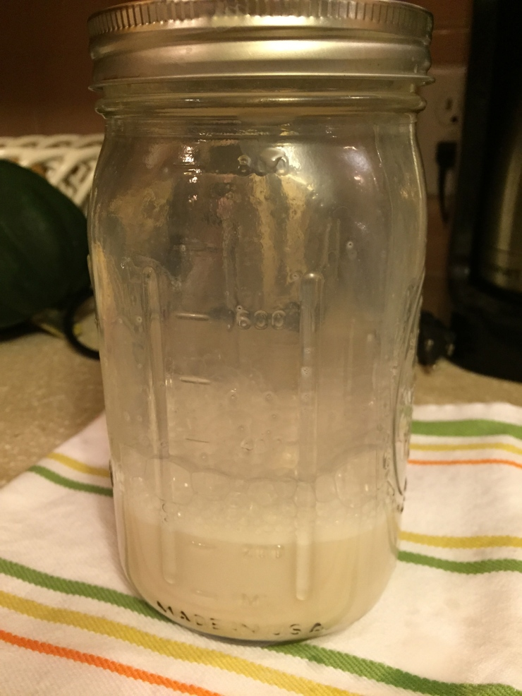 Shake the jar for at least 60 seconds, or until the milk has doubled in volume and has a nice, frothy top.