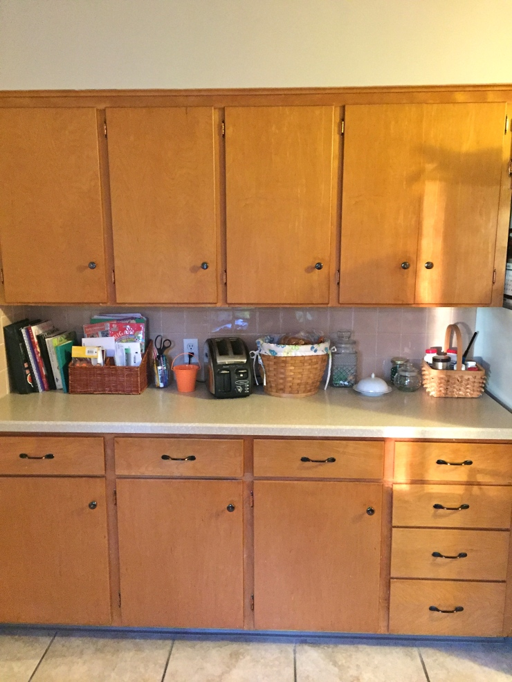 This is the space next to the refrigerator, on the opposite wall as our breakfast nook. As you can see, we have a ton of storage here! This is also where I store books/cookbooks I'm reading, our bread basket and toaster, and Theo's marble jar.